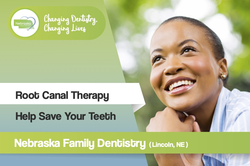 happy woman who has learned about root canal therapy and saving her teeth from dentist dentist in lincoln NE near me