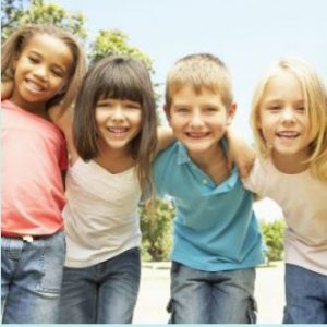 Image of young children who are are seeing a Lincoln dentist near me to learn the importance of excellent oral hygiene.
