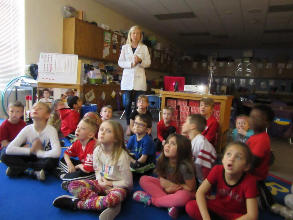 Image of a dentist near me in Lincoln, NE teaching kids about the importance of seeing a family dentist in Lincoln, NE.